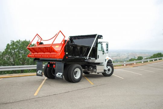 Warren GS-87 Tailgate Spreader mounted on WXL-10 Body